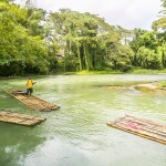 Montego Bay, Jamaica - February 11,2015:  Bamboo Rafting on the Martha Brae River, a popular tourist attraction in Jamaica.